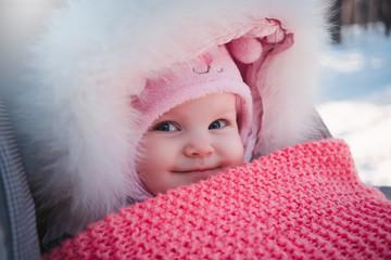 baby in stroller at winter walk.