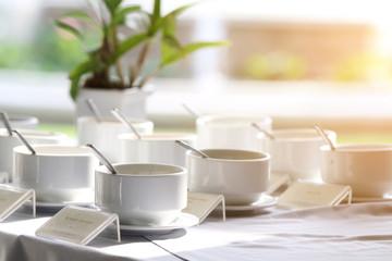 small bowls of seasoning at hotel breakfast in morning sunlight