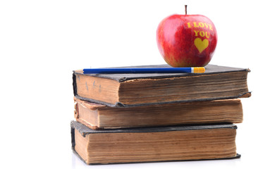Books and an apple on a white background