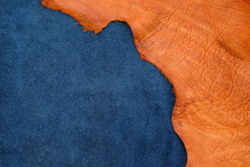 Close up orange rough edge and navy blue leather divide in two section, fashion texture background,fabric division