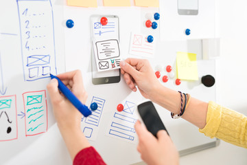 Designer drawing website ux app development.