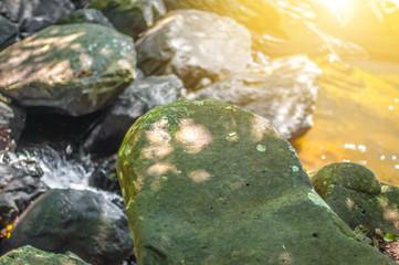 green moss and grey rocks