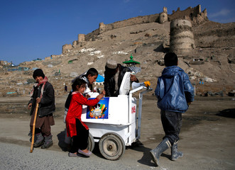 Children buy ice cream in Kabul