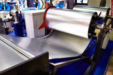 Rolls of sheet metal on industrial equipment