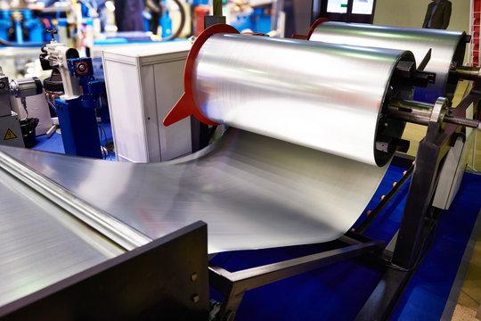 Rolls of sheet metal on industrial equipment