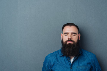 Bearded man with his eyes closed