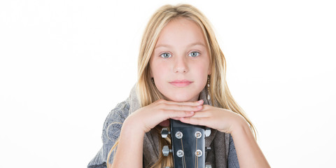 Close-up portrait of a casual pretty young blond girl with cute blue eyes