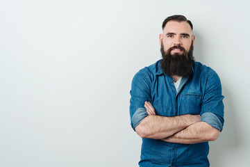 Bearded man staring at the camera with a smile
