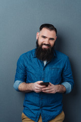 Attractive bearded man with a warm friendly smile