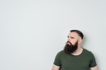 Bearded man in a green t-shirt on white