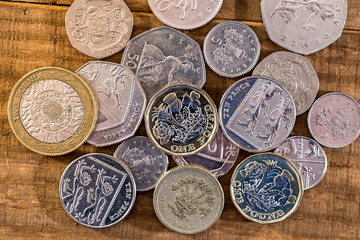 Pound - different british coin on table