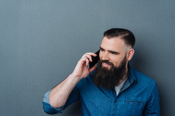 Attractive bearded man talking on his mobile