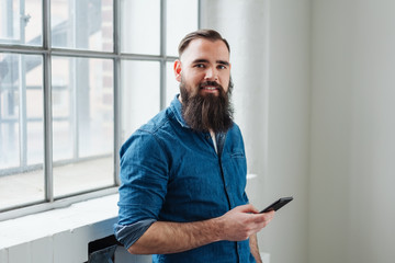Attractive relaxed young man with a bushy beard