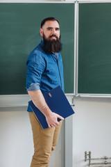Smiling male teacher or university student