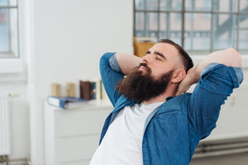 Bearded man taking a moment to relax