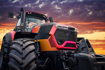 Fototapete - Modern tractor on sunset background