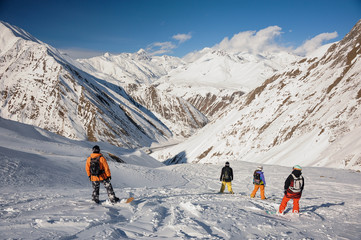 Back view of the group of snowboarders