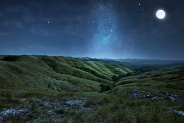 Scenery of green hills with stars