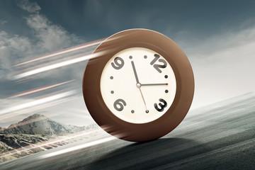 Analog clock rolling uphill