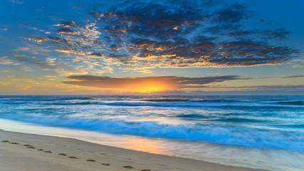 Vibrant Sunrise Seascape with Clouds
