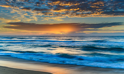 Vibrant Sunrise Seascape with Clouds