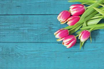 Beautiful fresh tulips on wooden background