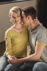 boyfriend kissing girlfriends neck at home
