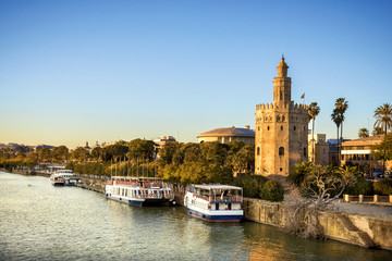 View of Golden Tower (Torre del Oro) of Seville, Andalusia, Spain over river Guadalquivir at sunset