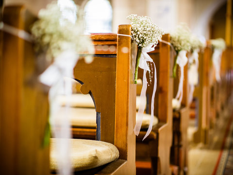 Beautiful decor of white flowers in church for a wedding ceremony in color