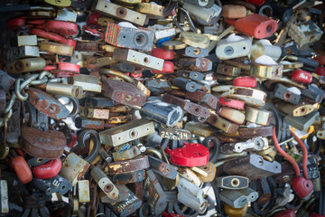 Beautiful and colorful love locks attached together for love wishes in a bridge