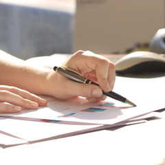 Business Woman Writing with pen