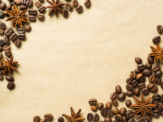 Coffee on paper background with coffee beans and star anise, copy space, top view.