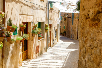 Printed roller blinds Dubai Beautiful street in Valldemossa with traditional flower decoration, famous old mediterranean village of Majorca. Balearic island Mallorca, Spain