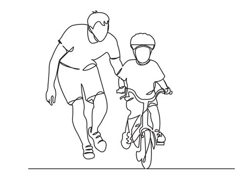 dad teaches a child to ride a bike
