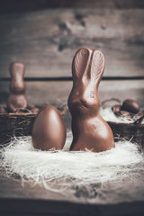 Chocolate Easter bunny and eggs on wooden backround