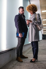 Adult stylish couple with smartphone