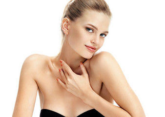 Charming fashion model. Beautiful blonde girl with perfect fresh skin smiling on white background. Youth and skin care concept