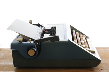Isolated typewriter against a white background. Empty copy space for Editor's text.