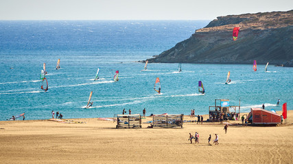 Windsurfers and kitesurfers riding at the Prasonisi kite beach at Rhodes island