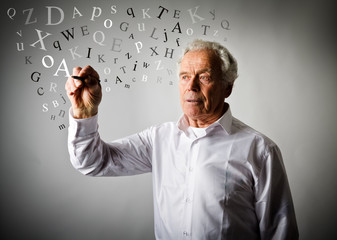 Old man is writing something. Letters.