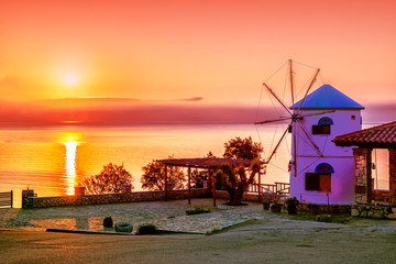 Greece. Island Zante. Dawn scenery. Traditional Windmill against sunrise scene of Ionian sea.