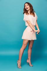 Full length portrait of a happy beautiful girl wearing dress
