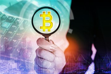 business woman hand holding magnifying glass with bitcoin icon and financial graph and stock market , cryptocurrency concept background