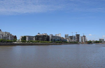 a city is being built, a new district with skyscrapers near the river, near the embankment