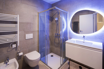 Modern marble bathroom with backlit mirror