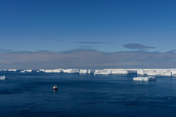 Antarctic landscape with expedition ship aerial view