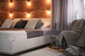 Cozy room interior with comfortable bed