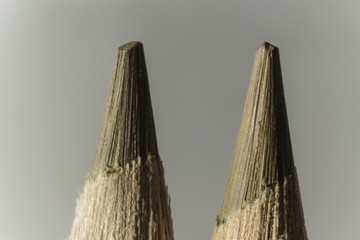 Macro photography of two brown pencils. Different shades of brown. Mechanical sharpening of pencils. Photo for the site about art, hobbies,education.