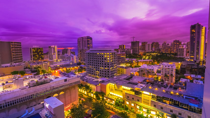 Violet twilight of cityscape of Waikiki in Oahu island, Hawaii, United States. City night lights and nightlife concept.