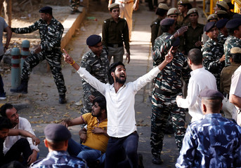 Activists of The Youth Wing Of India's Main Opposition Congress Party shout slogans during a protest demanding from government to disclose the purchase amount for Rafale fighter planes, in New Delhi